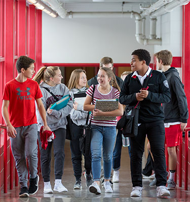 Red Knights walking in the halls for the start of another day