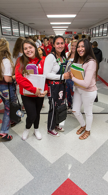 Students pose in hallway for photo