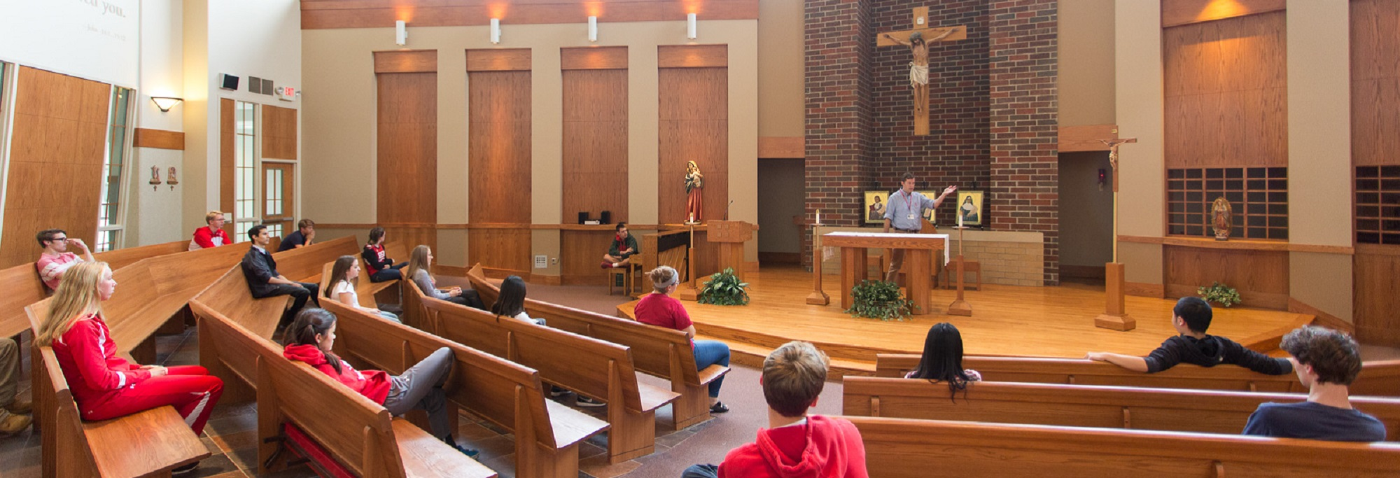 A theology class meets in the chapel to reflect on God's love