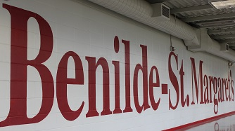 Hallway linking junior and senior high with Benilde-St. Margaret's painted in red on the wall.