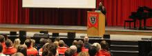 Speaker talks in front of school about racial justice